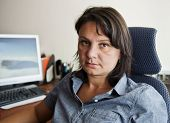 pic of ordinary woman  - Woman office worker at her workplace - JPG