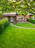 Front lawn of a brick house in England