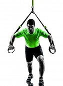 stock photo of suspension  - one caucasian man exercising   suspension training  trx   on white background - JPG