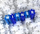 Creative 3D pieces of puzzle and word WINNER