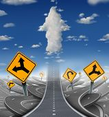 picture of goal setting  - Focused determination success concept with a road or highway going forward away from a group of confusing distractions fading into the sky with clouds shaped as an upward arrow as a business symbol of financial freedom - JPG