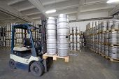 MOSCOW - OCT 16: Forklift loading beer kegs in stock brewery Ochakovo on October 16, 2012 in Moscow,