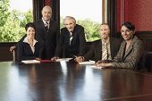 Portrait of confident multiethnic business team at conference table
