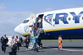 LA ROCHELLE, FRANCE - JUNE 24: People go out from the Ryanair plane in the airport of La Rochelle, F