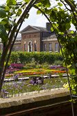 stock photo of kensington  - The Sunken Garden and Kensington Palace in London - JPG