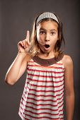 portrait of little girl with surprise expression
