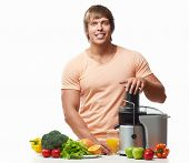 Athletic man with a juicer on a white background