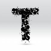 Letra T formado por manchas de tinta