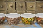 dinner leftovers (buckwheat kasha, vegetables, stir fry)  in glass  containers with drawer cabinet i