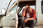 stock photo of stagnation  - Driver of the car is sitting thinking about something - JPG