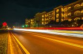 Street Scene Near Hotels In Destin Florida At Night poster