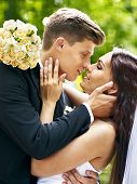 Bride and groom  kissing  outdoor.
