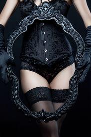 image of panty-hose  - Sexy slim girl in black underwear holding frame - JPG