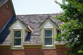 foto of gabled dormer window  - Two dormers in roof with wood shingles on a brick townhouse - JPG