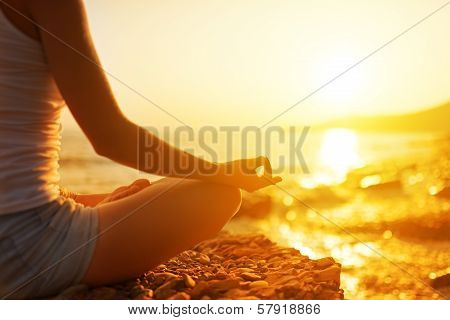 Hand Of  Woman Meditating In A Yoga Pose On Beach poster