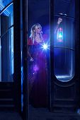 picture of night gown  - Lonely princess holding glowing lantern in his hand and explores old abandoned castle - JPG