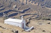 lonely white church on mountain slopes