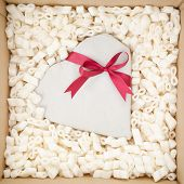 Heart Gift With A Red Ribbon