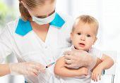 stock photo of squirting  - A doctor does injection child vaccination baby - JPG