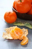 Peeled Fresh Mandarin With Bowl Of Mandarins