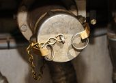 stock photo of fuel tanker  - Valving and meter area of a fuel pump station and valving on a local delivery MC 306 - JPG