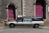 stock photo of funeral  - limosine parked in front of church - JPG