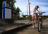 Girl Fuelling Bicycle