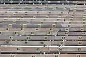 pic of grandstand  - Wooden Grandstand Seats with Numbers. Horizontal shot