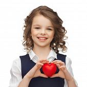 happy children, charity and health concept - picture of beautiful girl with small red heart