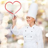 cooking, new technology , advertisement and food concept - smiling female chef with marker drawing r