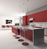 Modern open plan red kitchen interior with a long counter with bar stools and kitchen cabinets and appliances along the wall accented in red and white decor, spacious architectural background