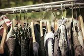image of thrift store  - clothes on a rack on a flea market - JPG