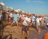QUARTEIRA, PORTUGAL -MAY 31, 2014: Fish festival where fisherman are showing traditional fishing act