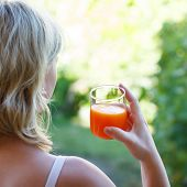 Blonde Woman Holding Juice
