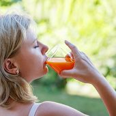 Blonde Woman Drink Multivitamin Juice