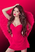Beautiful Girl Angel Model Dancing With Wings And Long Wavy Hair Style.