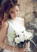 Bride Portrait. Girl With Wedding Bouquet Of White Flowers, Soft Tonality