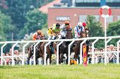 Group Of Jockeys Fight To Take The Lead Into The Last Curve