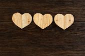 picture of driftwood  - Love Valentines wooden hearts from recycled old palette on rough driftwood background copy space - JPG