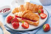 picture of croissant  - fresh croissants with jam and strawberry for breakfast - JPG