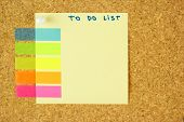 To do list schedule sticker pined on the corkboard