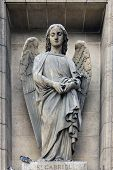 PARIS,FRANCE - NOV 09,2012: Archangel Gabriel, architectural details of Eglise de la Madeleine. Madeleine Church was designed in its present form as a temple to the glory of Napoleon's army.