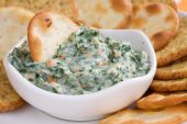stock photo of dipping  - Creamy and flavorful spinach dip served with crackers - JPG