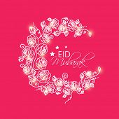 Beautiful floral design decorated crescent moon on pink background for the occasion of Muslim commun