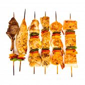 Tasty grilled meat on a white background, shish kebab