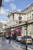 LONDON, UK - JUNE 30, 2014: Bank of England building. Busy street with traffic and busses