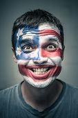Funny Man With Us Flag Painted On Face