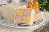pic of sponge-cake  - Battenberg Cake or Battenberg Square a sponge cake with pink a yellow checks covered in marzipan - JPG