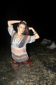 Beautiful Young Woman In The River