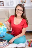 picture of belly-band  - Portrait of a teenage girl taught lessons sitting on the floor at home - JPG